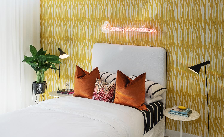 aston_milan_display_home_helensvale_surrounds_bedroom_yellow_wallpaper_palm_springs_style.jpg