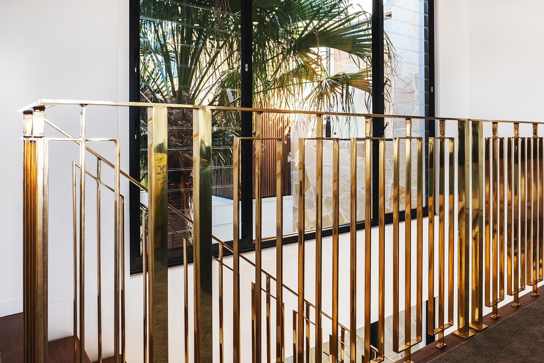 aston_milan_gold_staircase_luxury_glamour.jpg