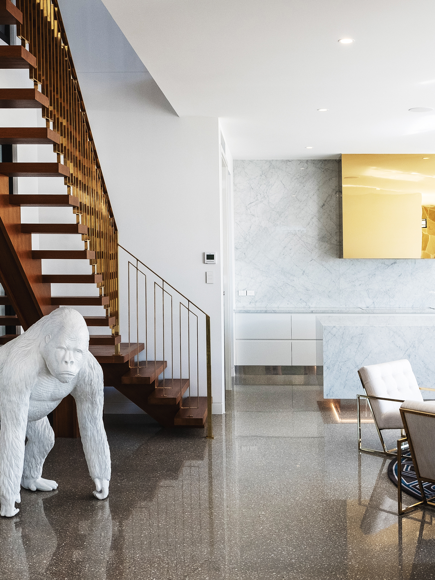 aston_milan_helensvale_surrounds_kitchen_gold_staircase_glamorous_luxury_luxe.jpg