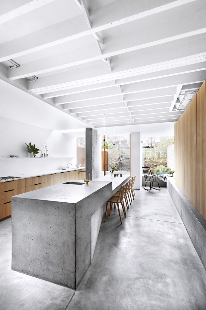 OUR HOT TIP - I just adore everything about this kitchen, from the concrete floors through to the exposed beams on the ceiling – it's utter industrial perfection. And whilst there is a lot of concrete in the space, it doesn't feel heavy or cold. The simple design trick? Balance with a whole lot of white and timber cabinetry!