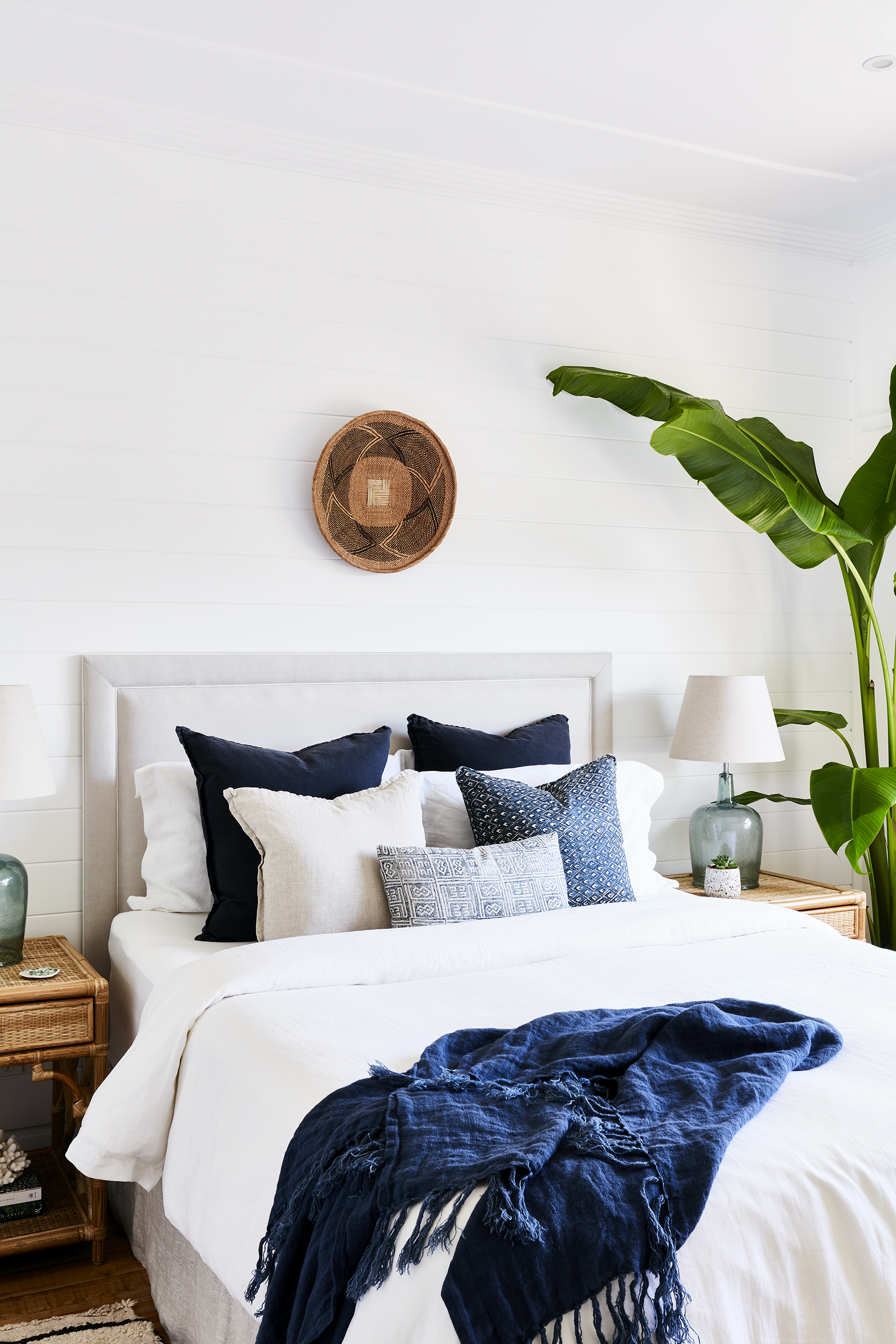 """COASTAL RETREAT - """"I wanted the bedroom to feel seamless with the rest of our home with neutral colours and white walls. My favourite aspect is the horizontal shiplap wall which adds depth and offers another dimension to the room,"""" says Maddy."""