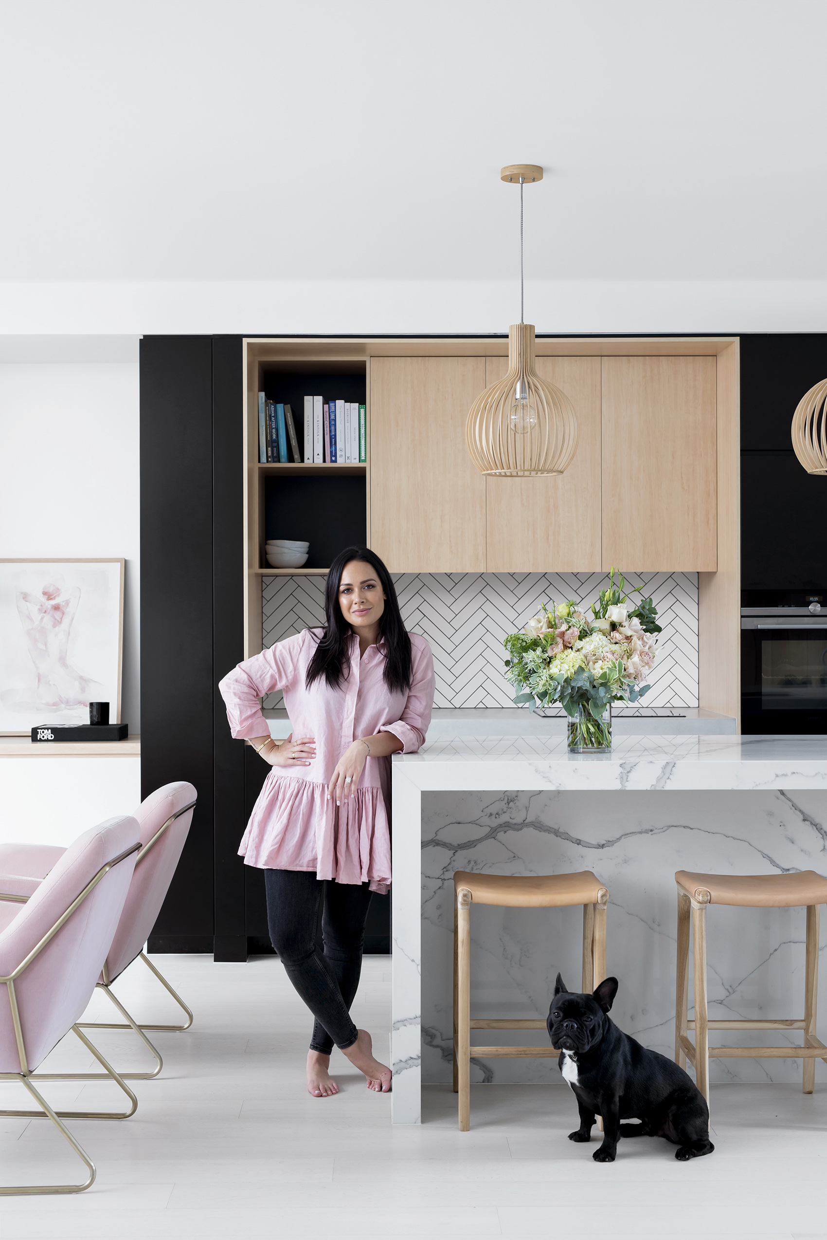 """HUB OF THE HOME - """"The kitchen is the hub of our home – it's where we do a lot of entertaining. It's functional and very practical for a family. It has everything you need without being overdone,"""" remarks Kayla. Stools from MRD Home; pendant lights from Beacon; flowers from White Havana."""