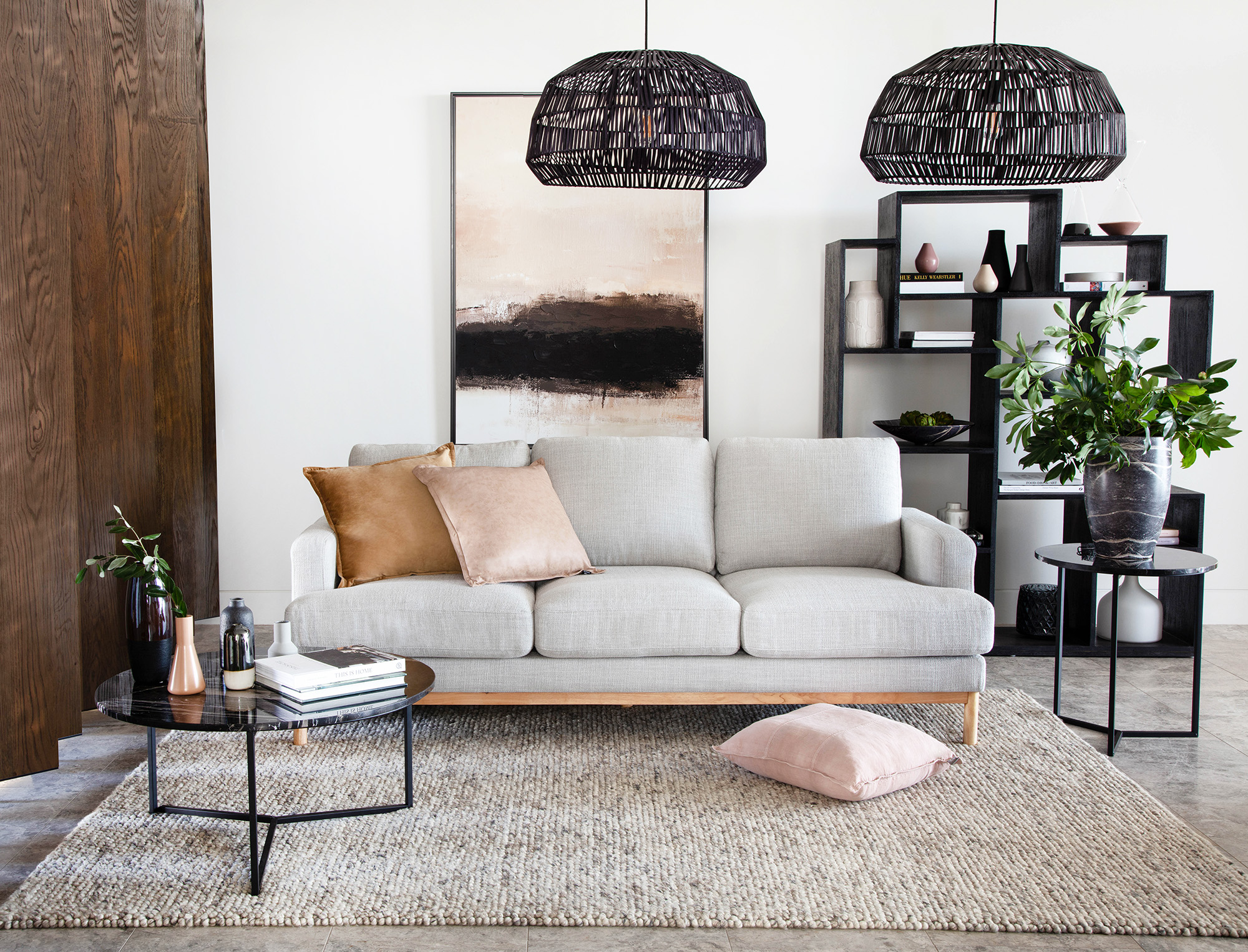 Pictured: Atticus 3 seater sofa, Union coffee and side tables, Porto bookcase, Natural Abstract art.