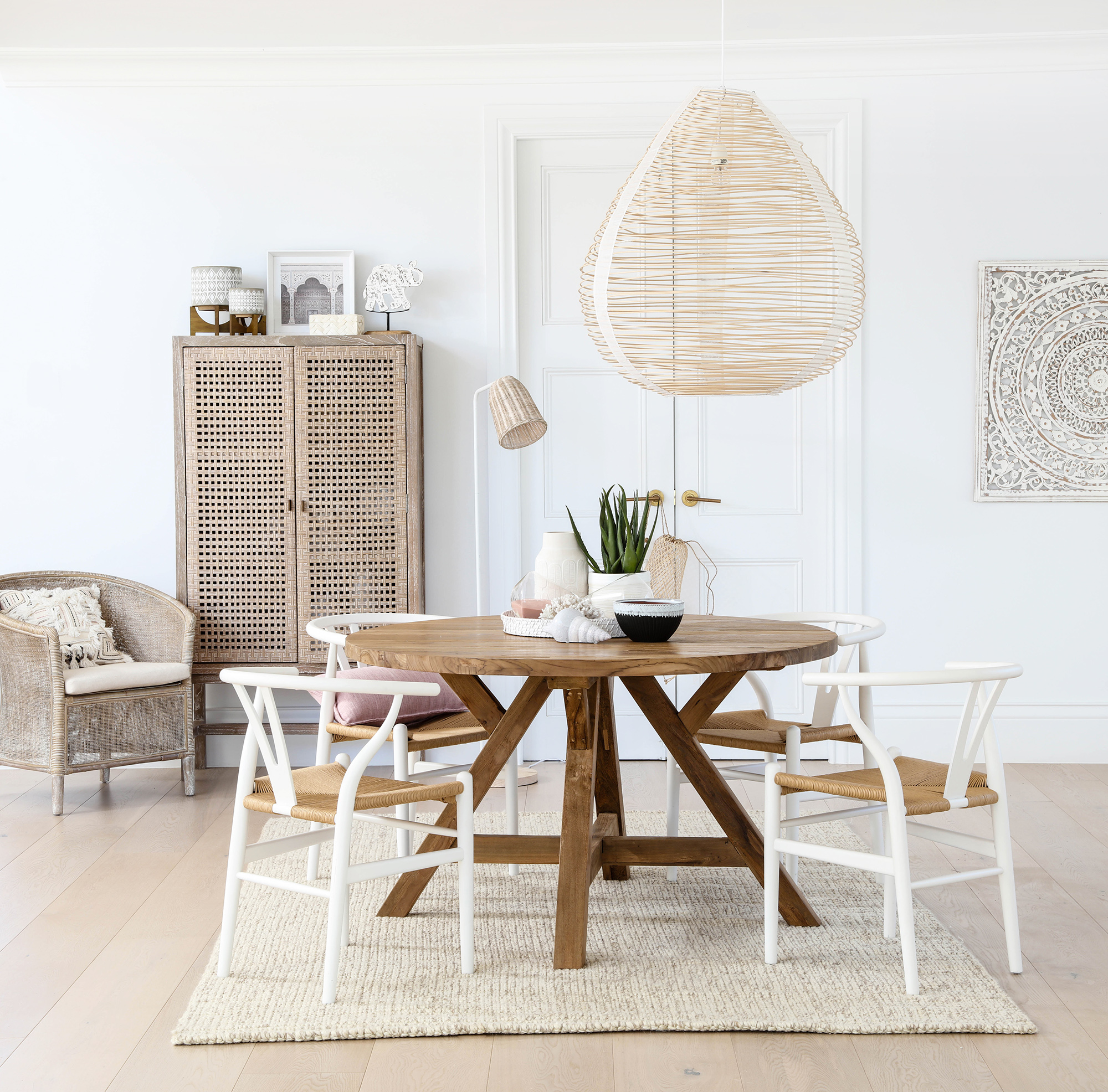 Pictured: Kenyo dining table, Megs wishbone chairs, Maya cabinet, Sky occasional chair.