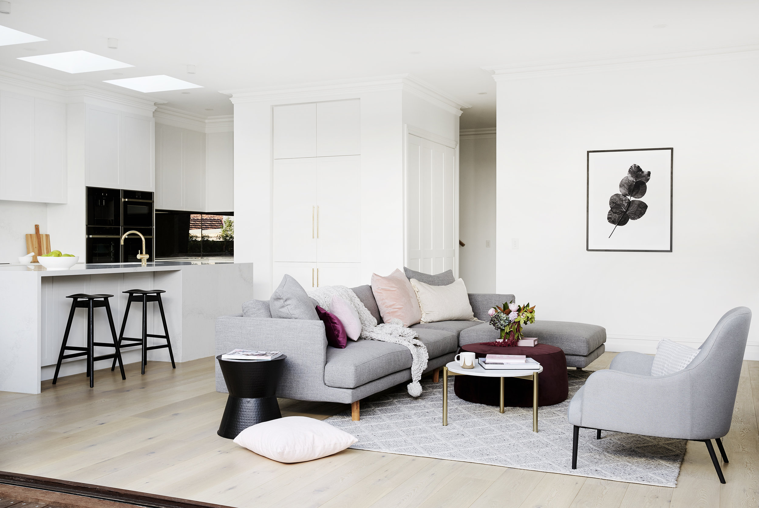 Julia and Sasha hired  The Real Estate Stylist  to help furnish and style the home before putting it on the market.  Sofa from GlobeWest; rug from Tribe Home; ottoman from Retrojan.