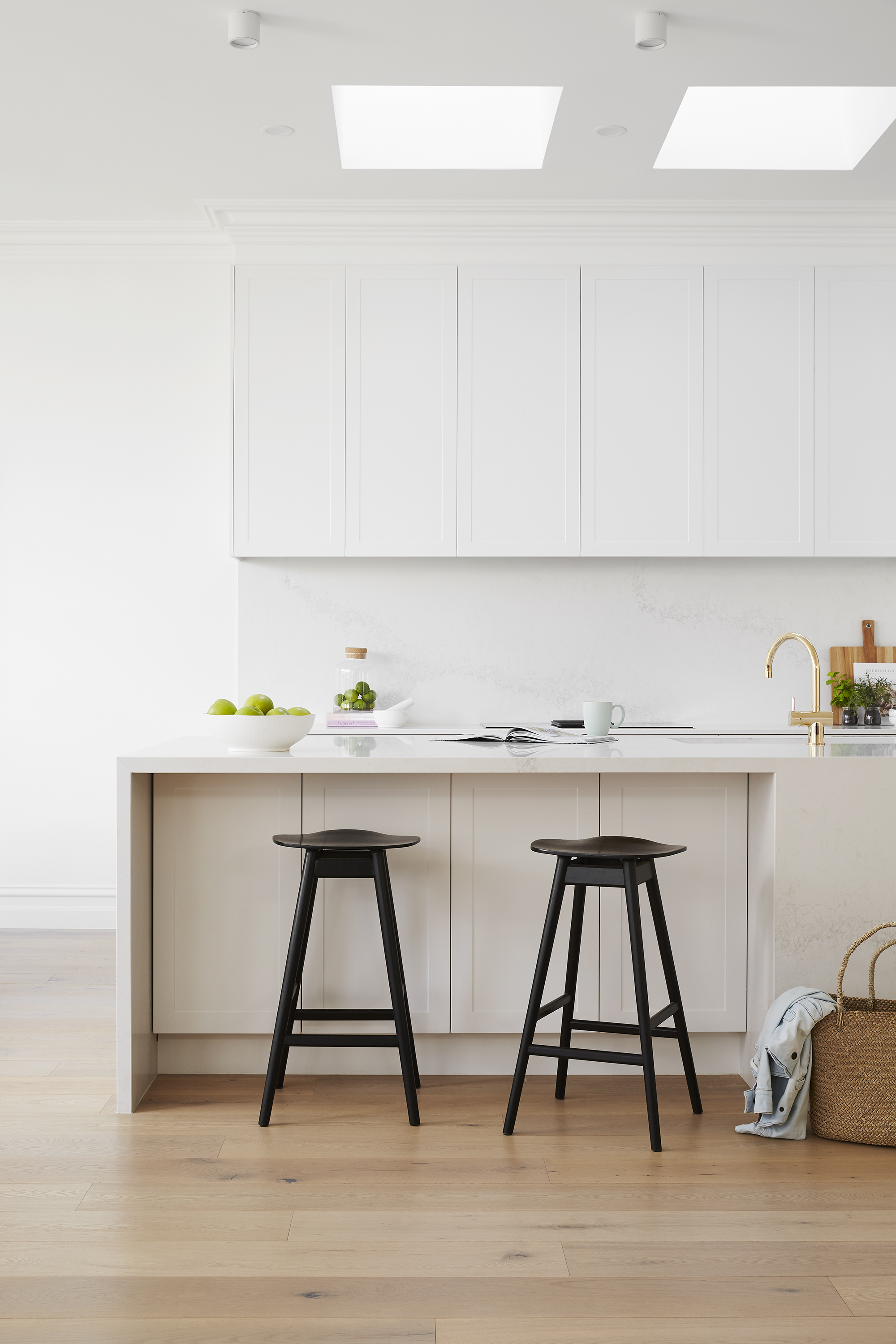 Julia and Sasha went with a timeless, all-white kitchen by Freedom Kitchens. All appliances by NEFF; integrated fridge/freezer from Bosch; Caesarstone 'Calacatta Nuvo' benchtop and splashback; Sussex tapware and Franke white sinks from Reece; skylights by Velux.