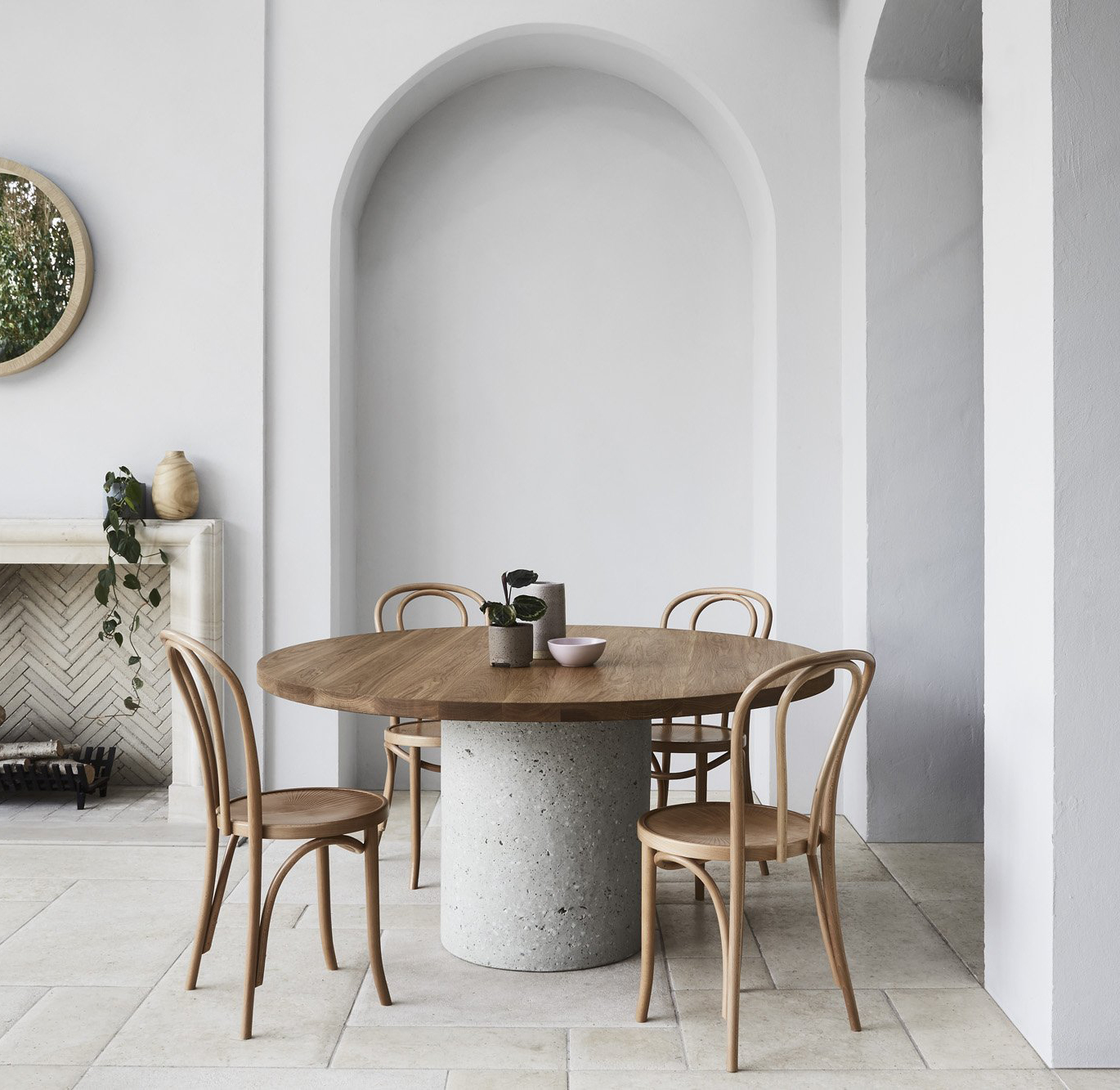 Concrete cylinder dining table from Harpers Project