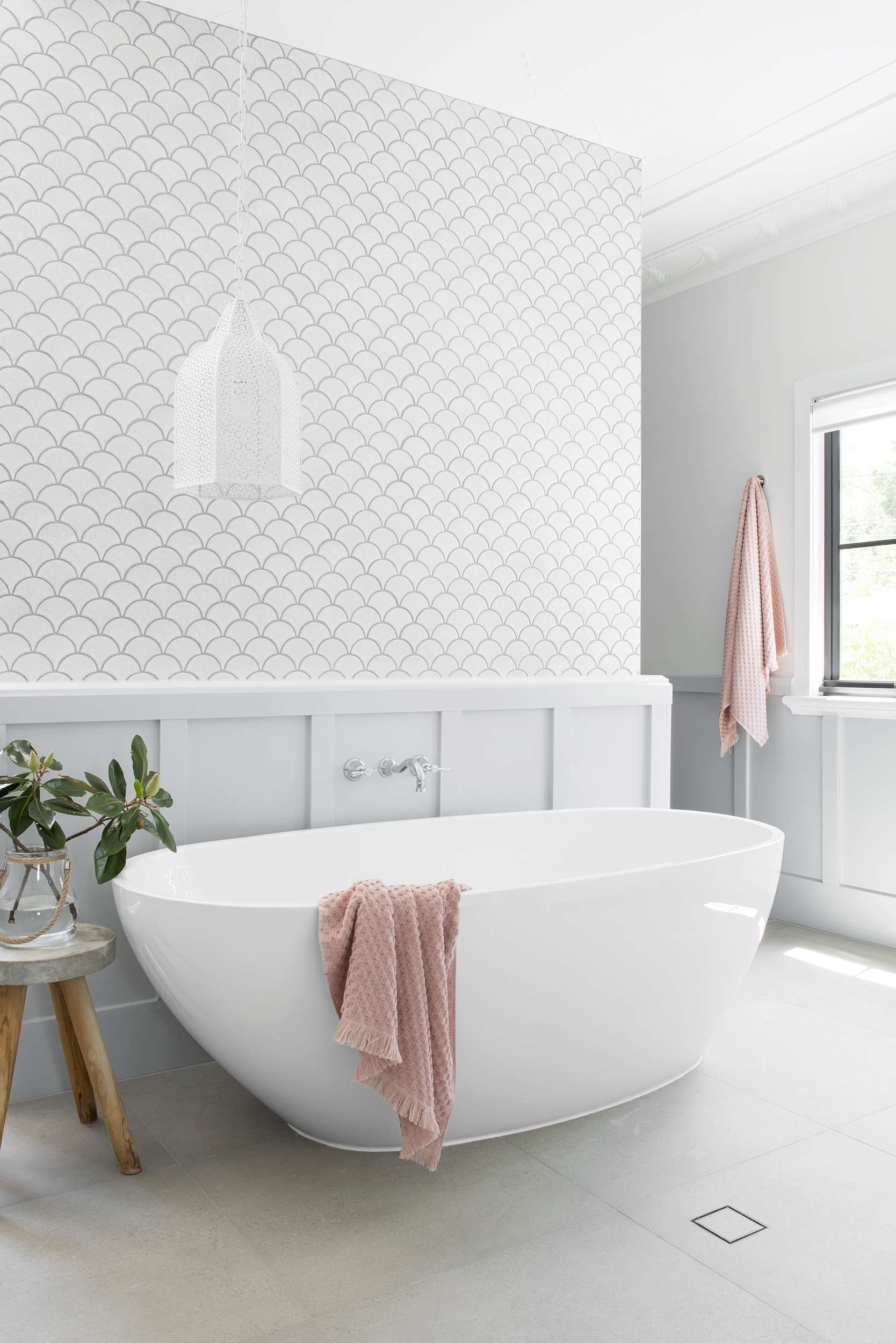 The ensuite was formerly a bedroom. Due to its large size, Rachael decided to build a wall in the middle of the room to keep the space from feeling too vast. Tiles from TileCloud.