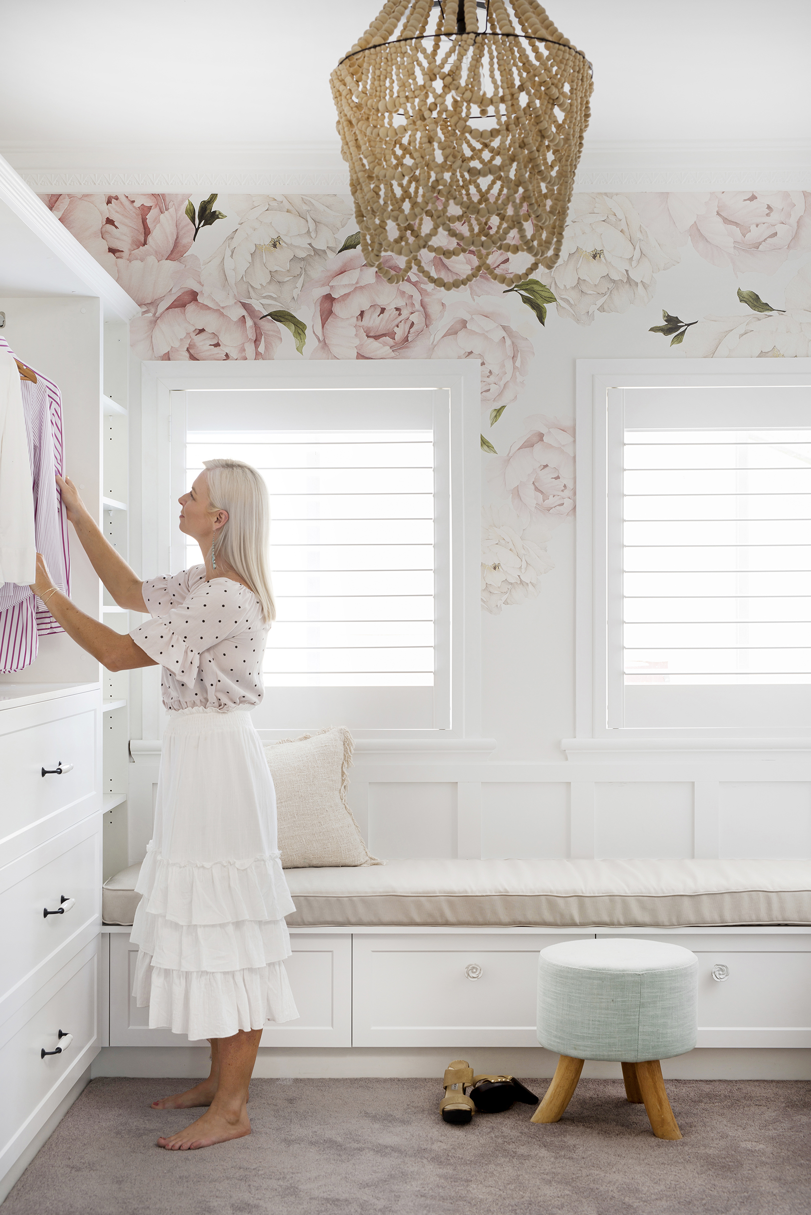 Individual flower wall decals from Rocky Mountain Decals create a dreamy, romantic space. Plantation shutters from DIY Blinds; pendant light from Wanderlust 4 Lighting; cabinetry hardware from Tradco Hardware; carpet in upstairs bedrooms and walk-in robe by Godfrey Hirst.