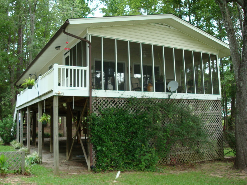 When we were contacted, this house was 10 feet in the air and overlooked Lake Wateree.