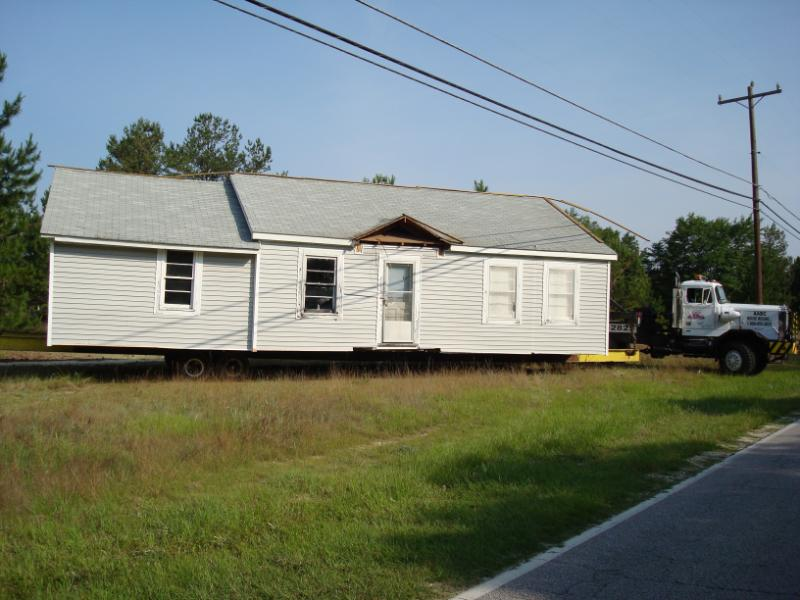 This house, shown in tow, has been successfully moved to its new location.
