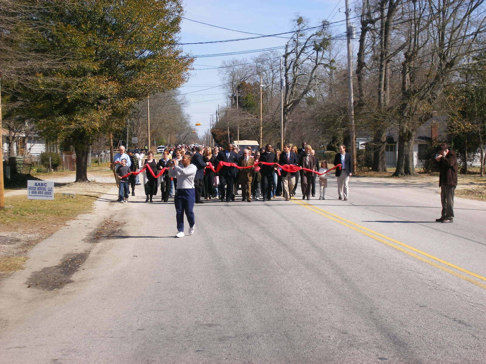 Approximately 300 people marched to the ribbon-cutting ceremony.