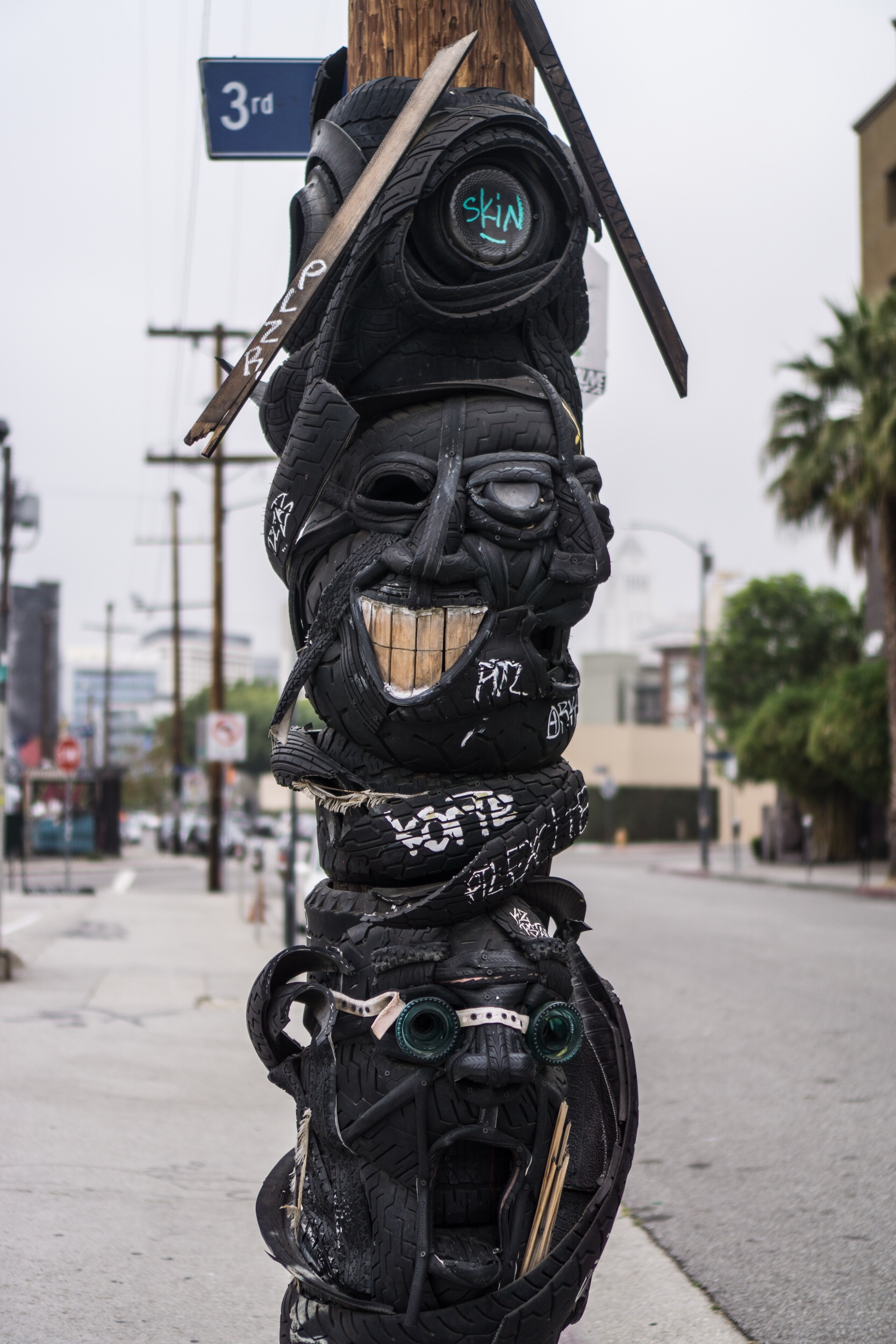Tire art on a phone pole