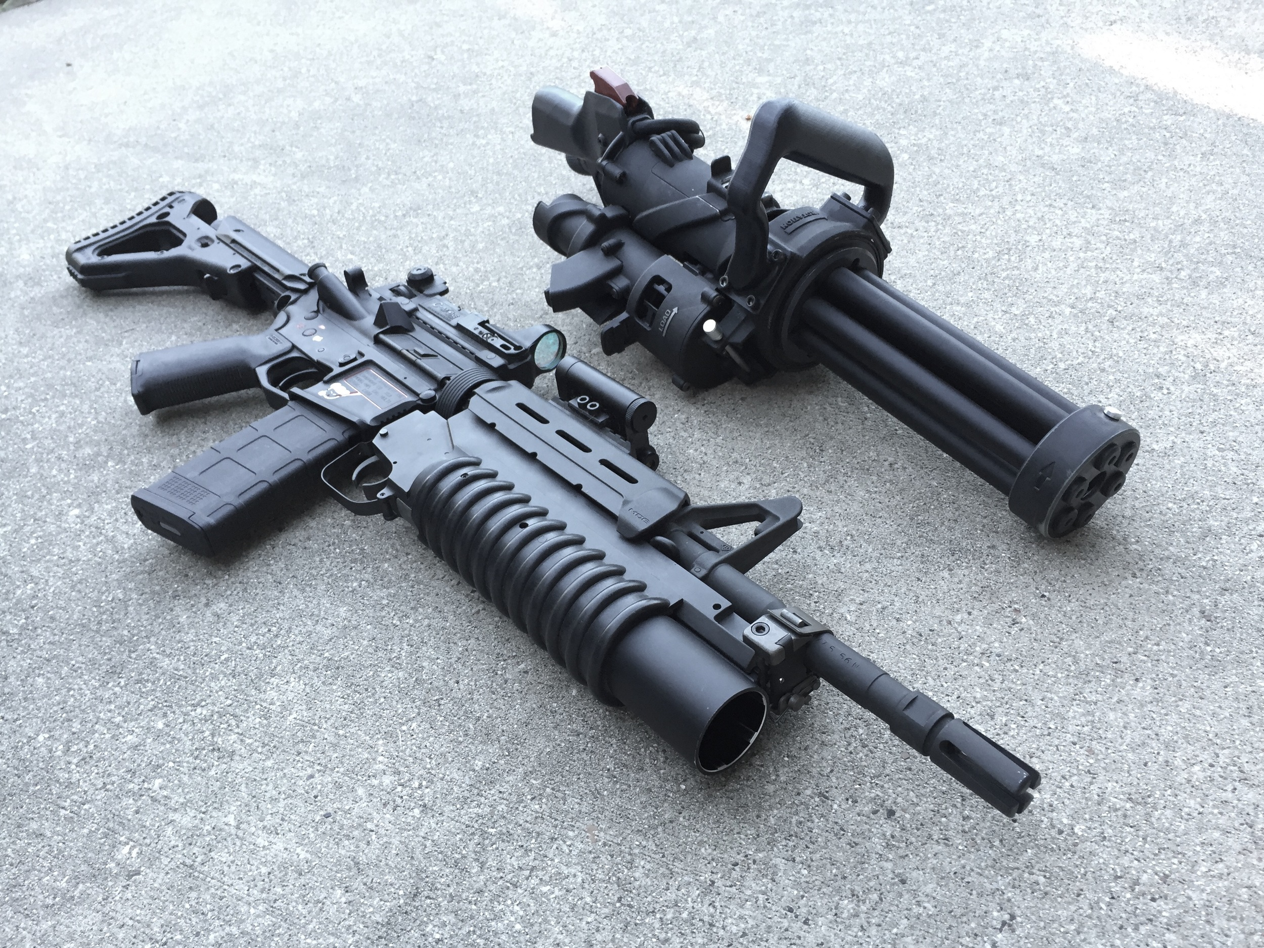 XM556 Microgun next to a Standard M4 with M203.