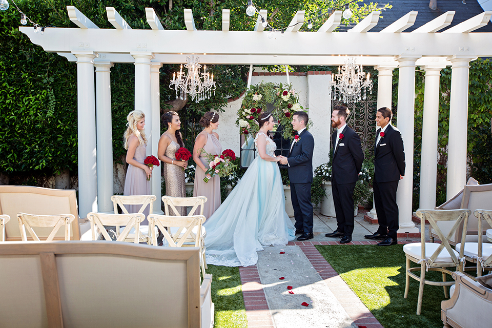 Orange-county-wedding-at-the-five-crowns-ceremony-bride-and-groom-holding-hands.jpg