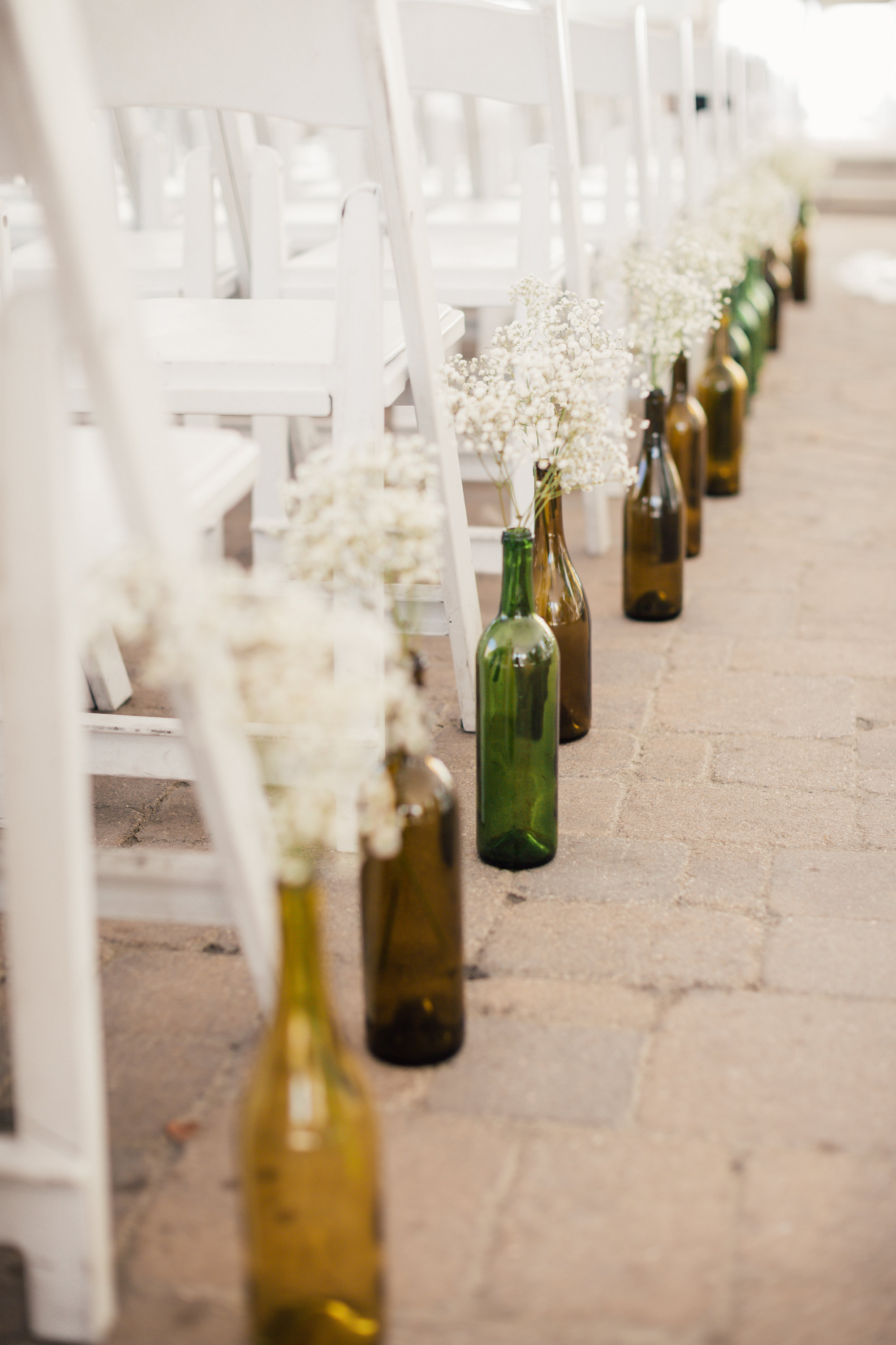 Kelly and Chris Wedding-wine bottles with babys breath-0004.jpg