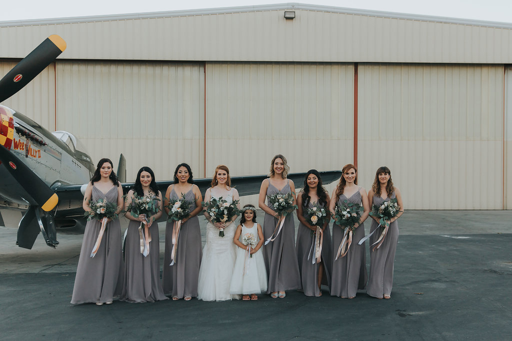 bridal party airplane in the back.jpg