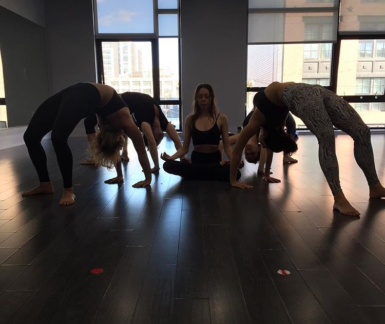 Yoga instructor Danielle Ciniello, center, finding her inner peace at Real Hot Yoga in New Jersey.