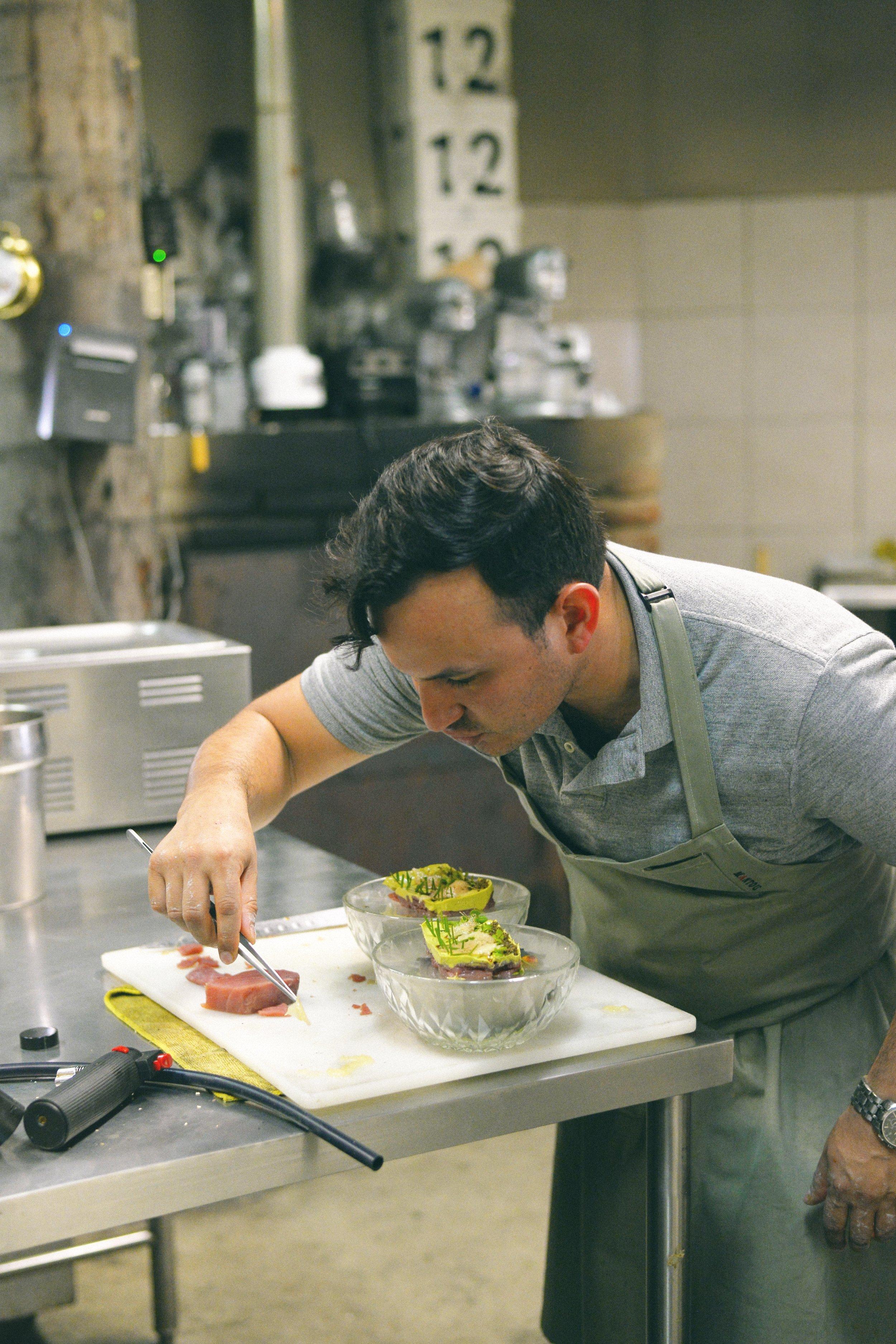Chef Omar Armas of Mantou assembling his tuna dish