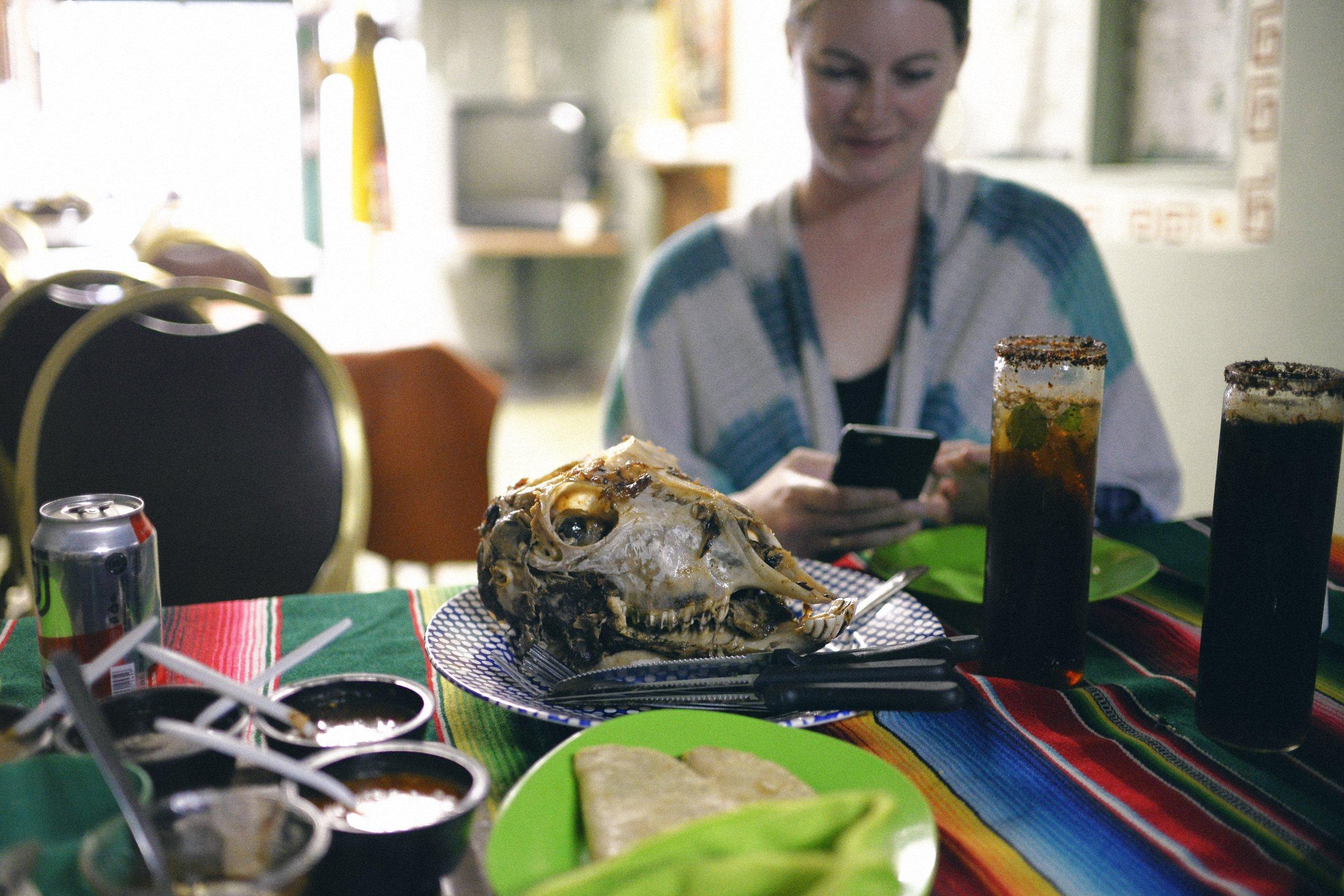 Tacos de cabeza de borrego (and me, obviously instagramming) at Tacos de Huitzilopochtli
