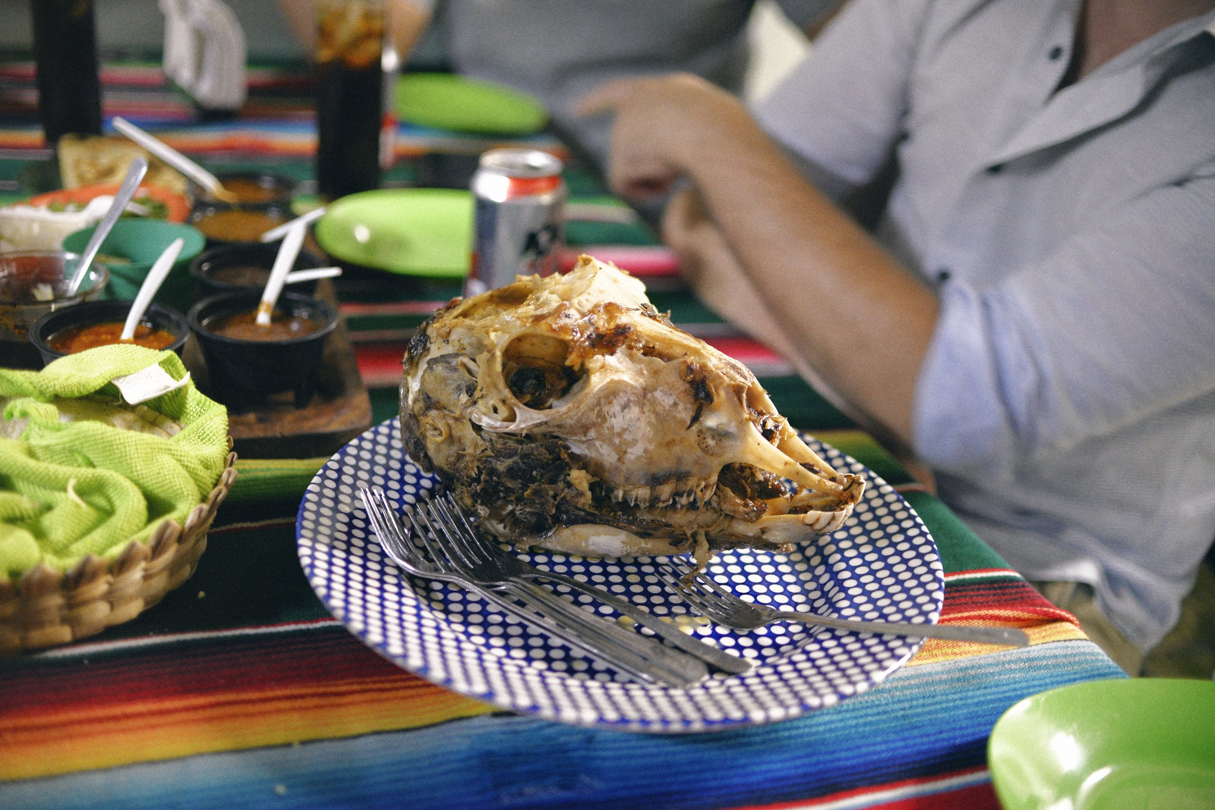 The piece de resistance: scooping from the lamb's head to get the taco meat