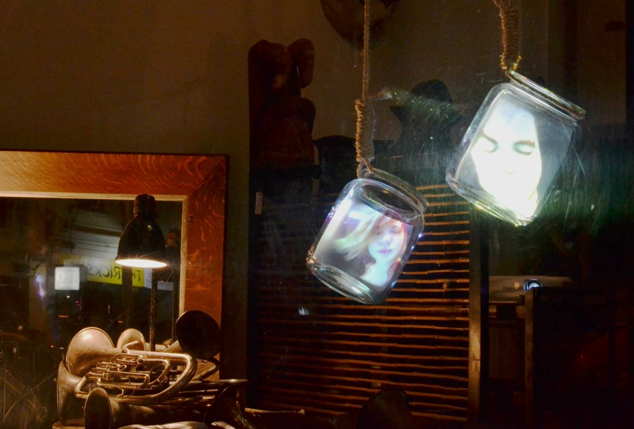 Young Blood, by Arika Waulu, hangs in a shop window at the 2014 Gertrude Street Projection Festival.