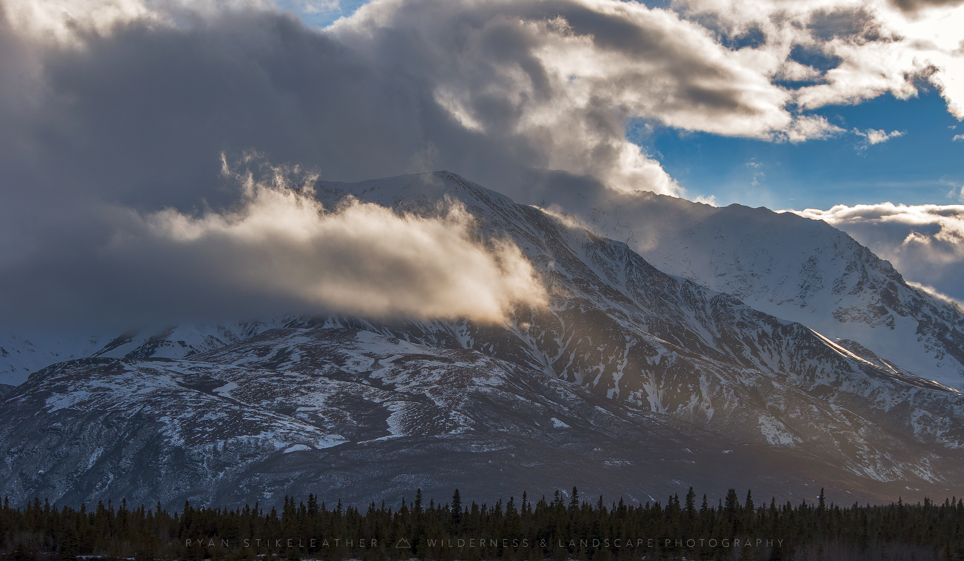 Rainbow Ridge shrouded in fog and snow—photo by   Ryan Stikeleather