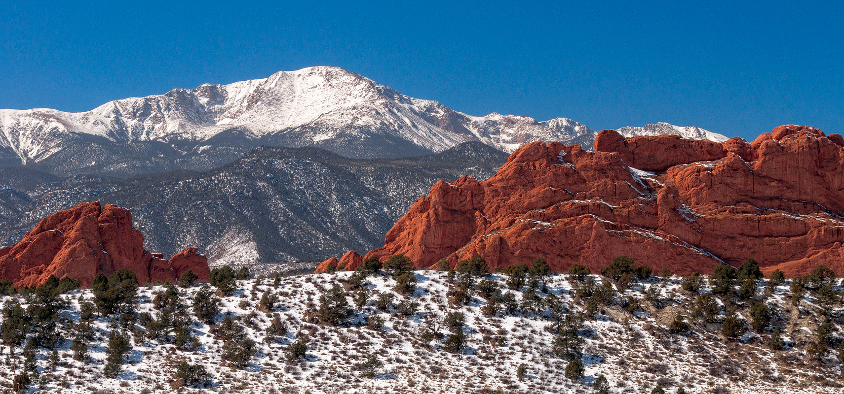 Red Rocks And Snow Caps