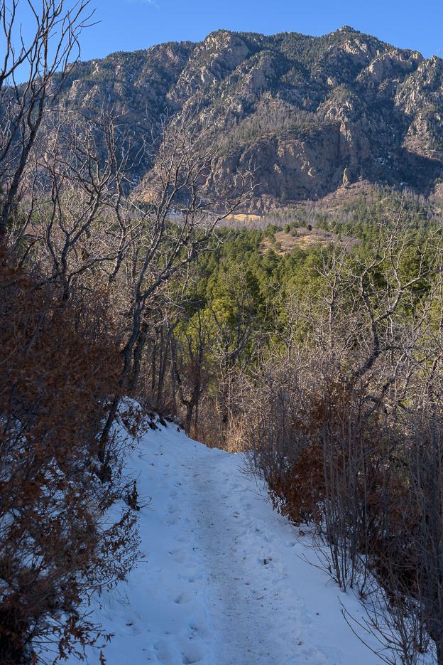 Shadows keep the snow on the trail