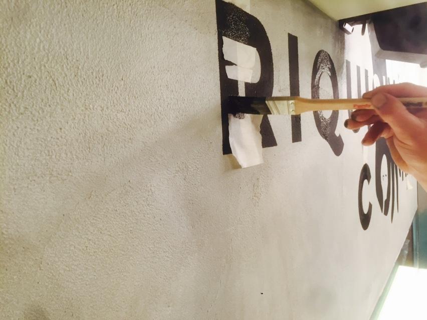 Ian stencilling at Wahaca Brighton - interiors - paintwork