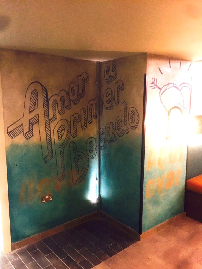 Ian stencilling at Wahaca Brighton - interiors