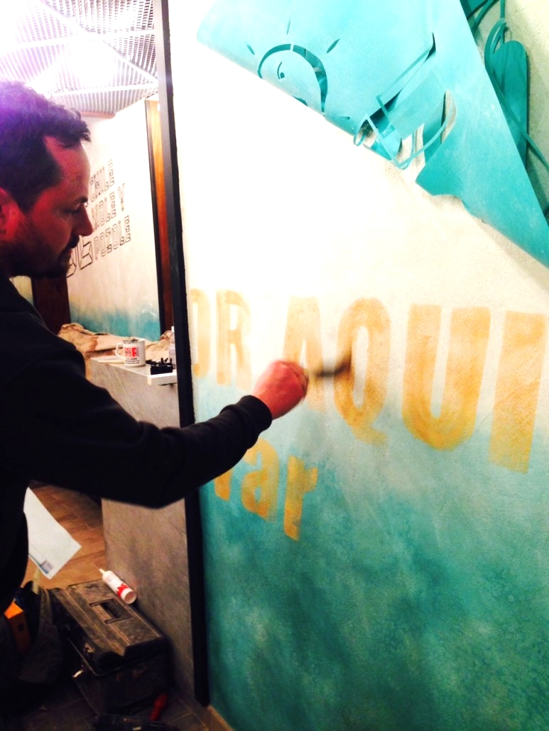 Ian painting lettering at Wahaca Brighton - interiors.