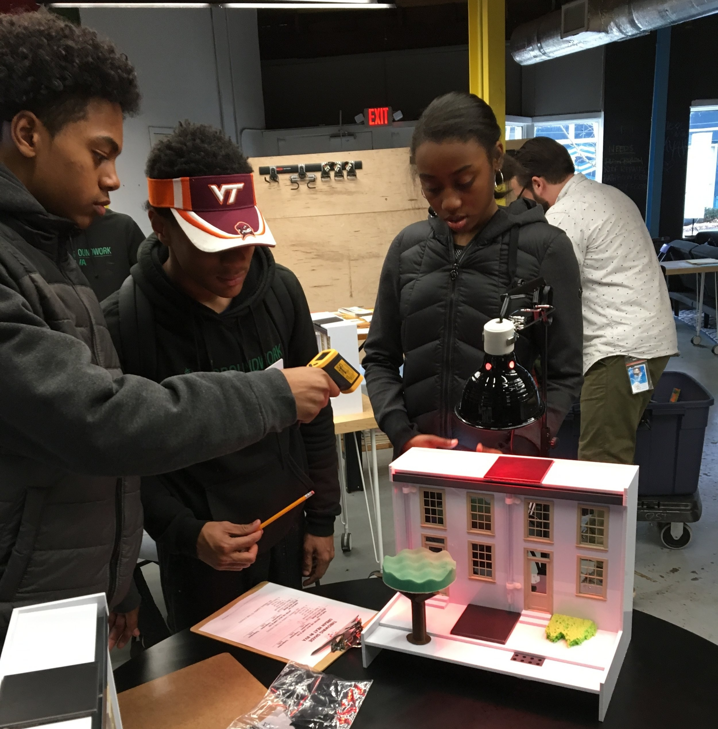 Hands-on science - GroundworkRVA Green Team students explore the drivers of urban heat islands (paved, dark surfaces) and their solutions (green infrastructure like native plants) using infrared cameras and thermometers.