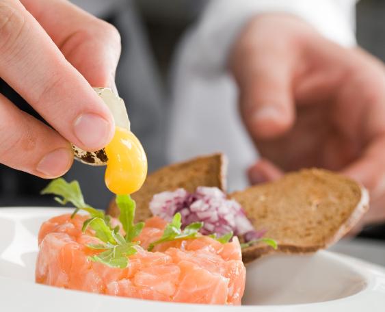 Restaurant Chef Fixing Salmon Salad
