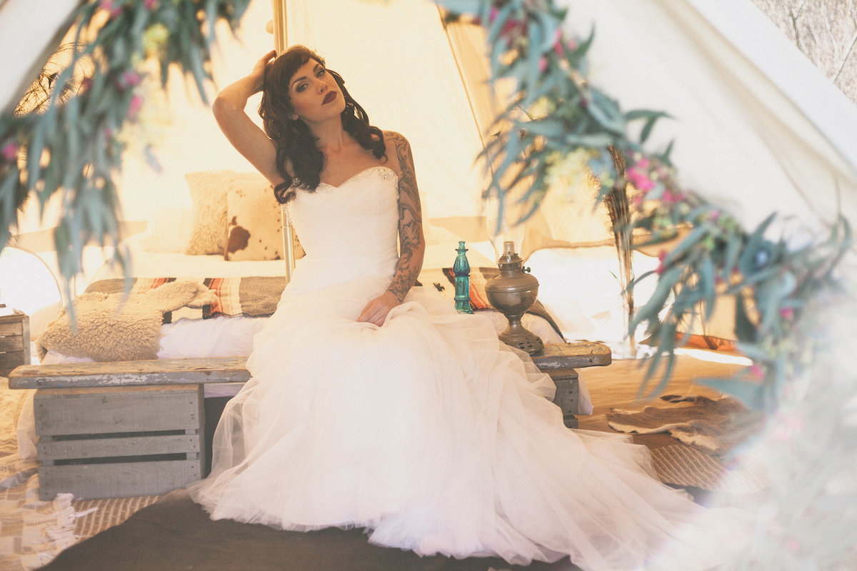 Tinker Tin's bell tent was styled into this dreamy outdoor honeymoon suite, creating the perfect setting for this outdoor Bohemian wedding inspiration shoot! Photo by Alexandra Wallace.