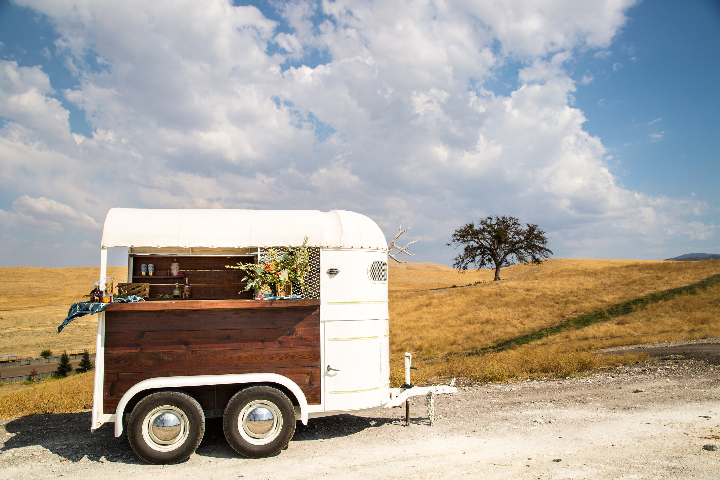 Our 1948 horse trailer bar makes every event more fun! This bar and vending trailer can also be  customized with your company's branding and a styled lounge to create the perfect experiential marketing experience!