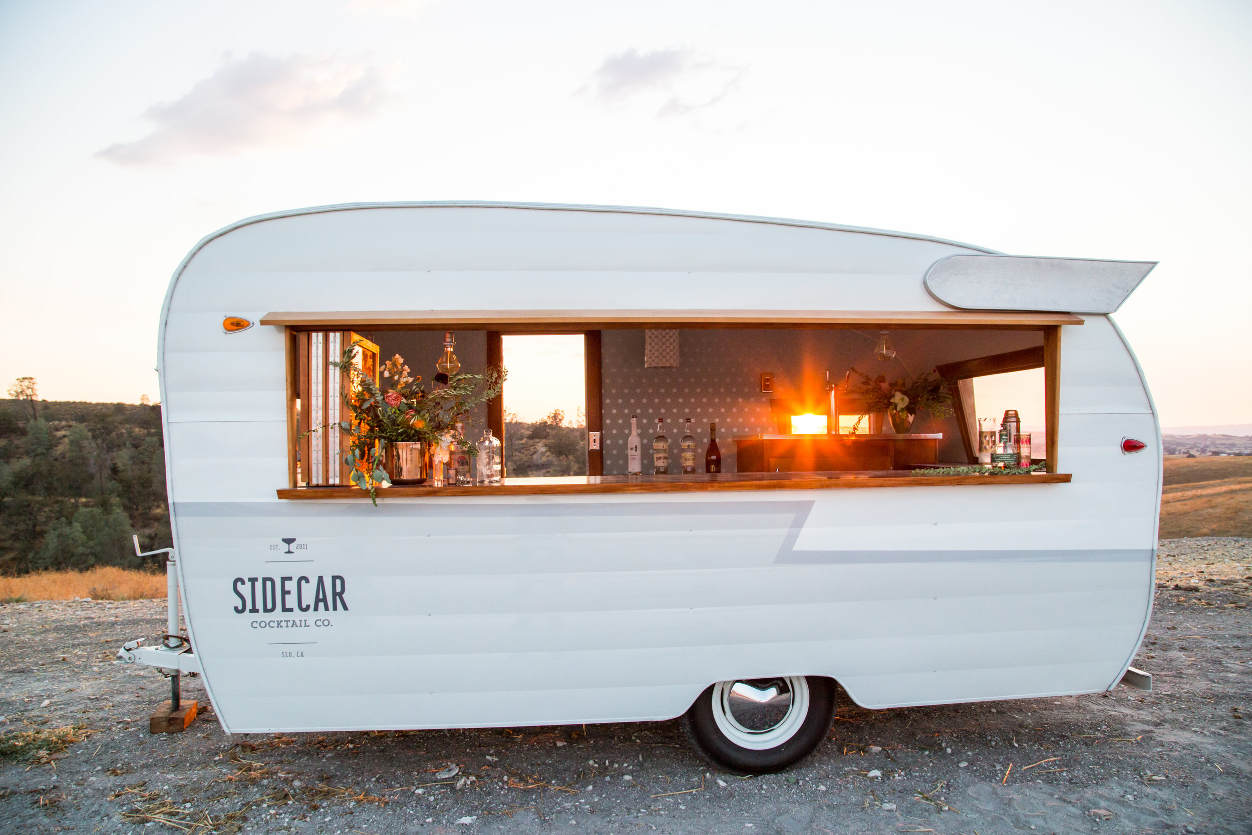 Our Sidecar Shasta bar turns is a head turner.... with its folding window, modern design and sleek paint job - it fits in wherever it goes! We partnered up with our favorite craft cocktail catering company,  Sidecar Cocktail Co.  to make sure that only the best drinks are served out of her window!