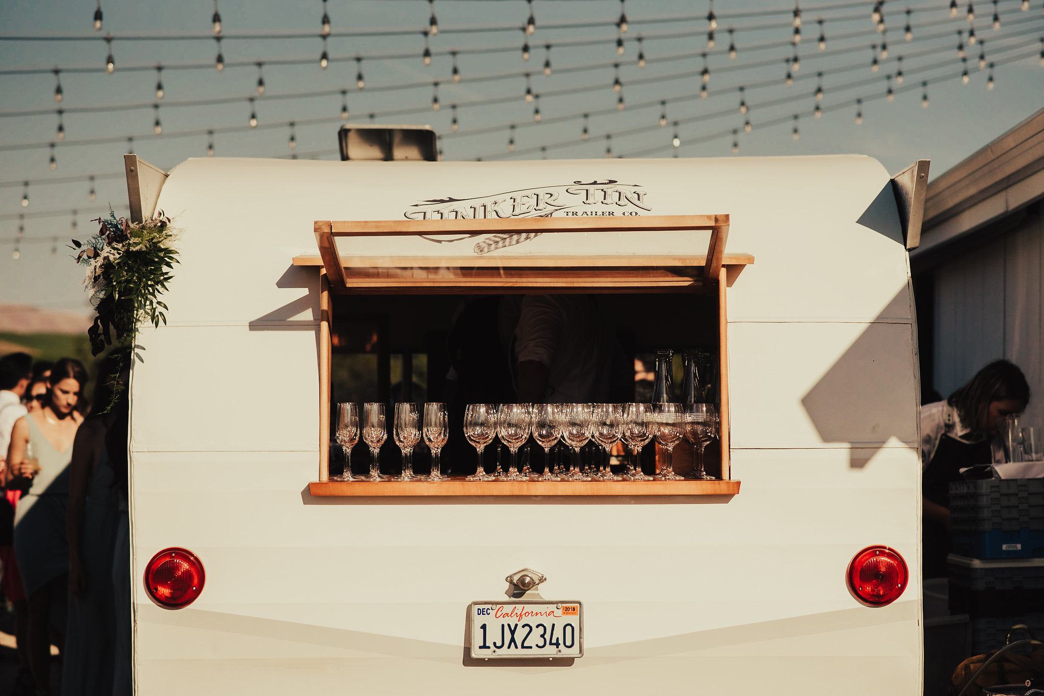 A rear shot of Tinker Tin Trailer Co.'s vintage mobile bar trailer, the Sidecar Shasta