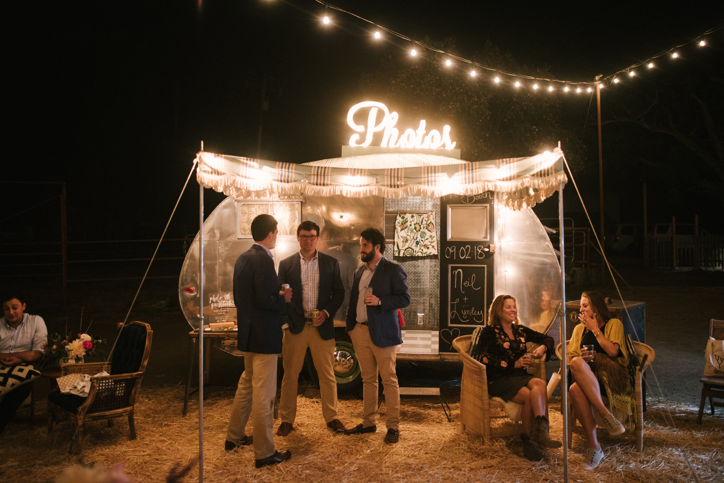 A perfect evening shot of Tinker Tin Trailer Co.'s vintage photo booth trailer and their light up photo sign. The most fun and unique photo booth option in California and the Western United States