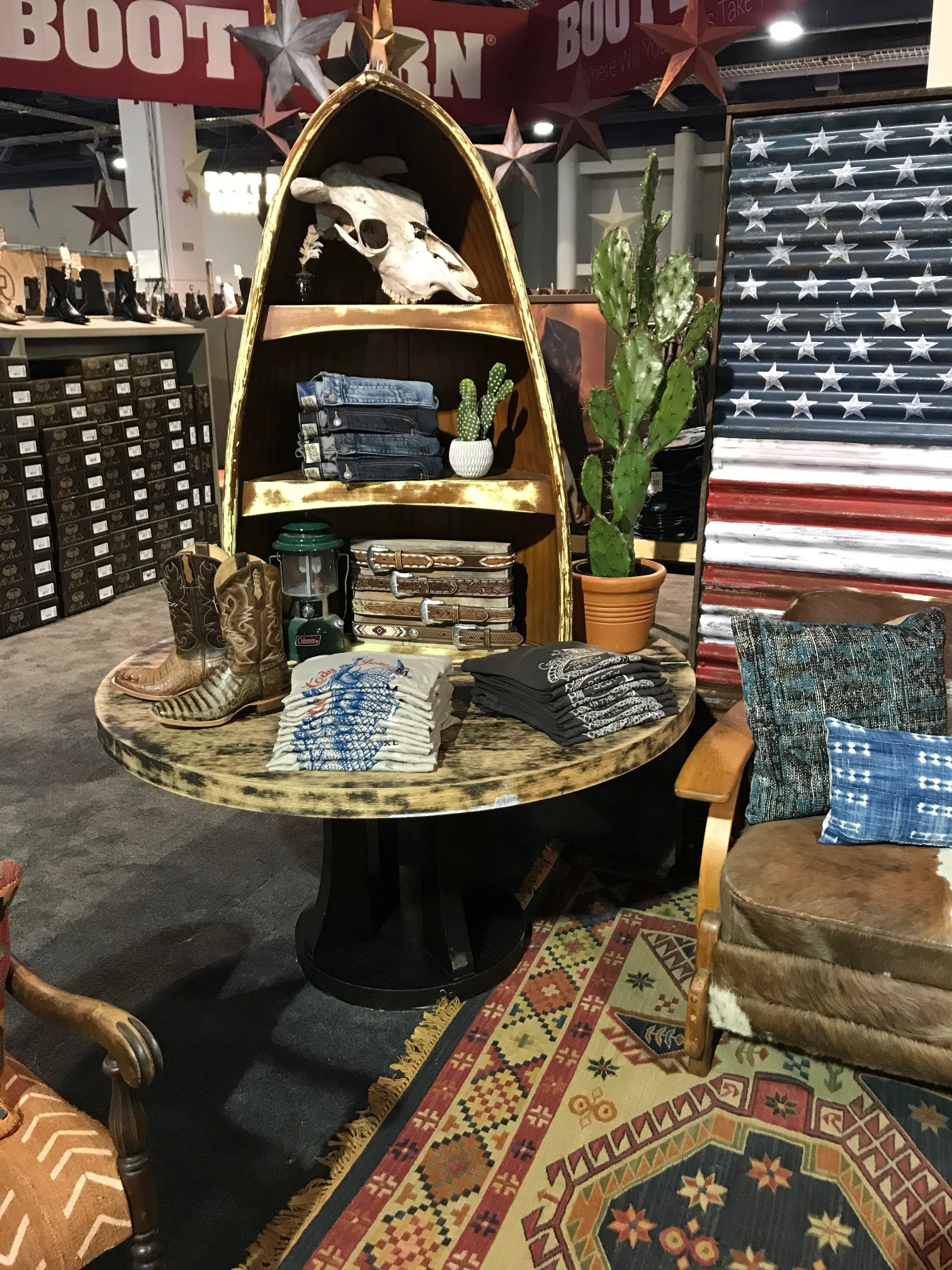 Custom built Southwestern Ralph Lauren inspired canoe table retail display for expo center build out at the National Finals Rodeo Cowboy Christmas