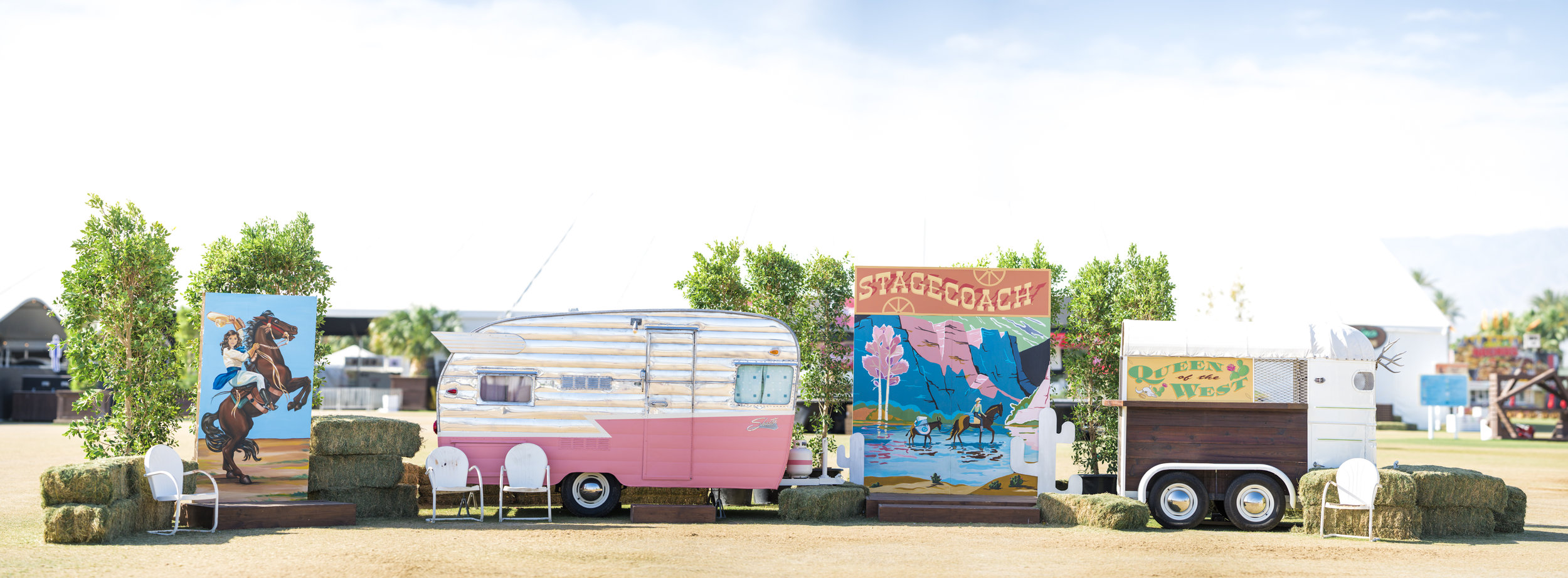 Custom branded vintage trailer with styled lounge + step & repeat wall for festivals, trade shows, branded pop-ups and experiential marketing campaigns.