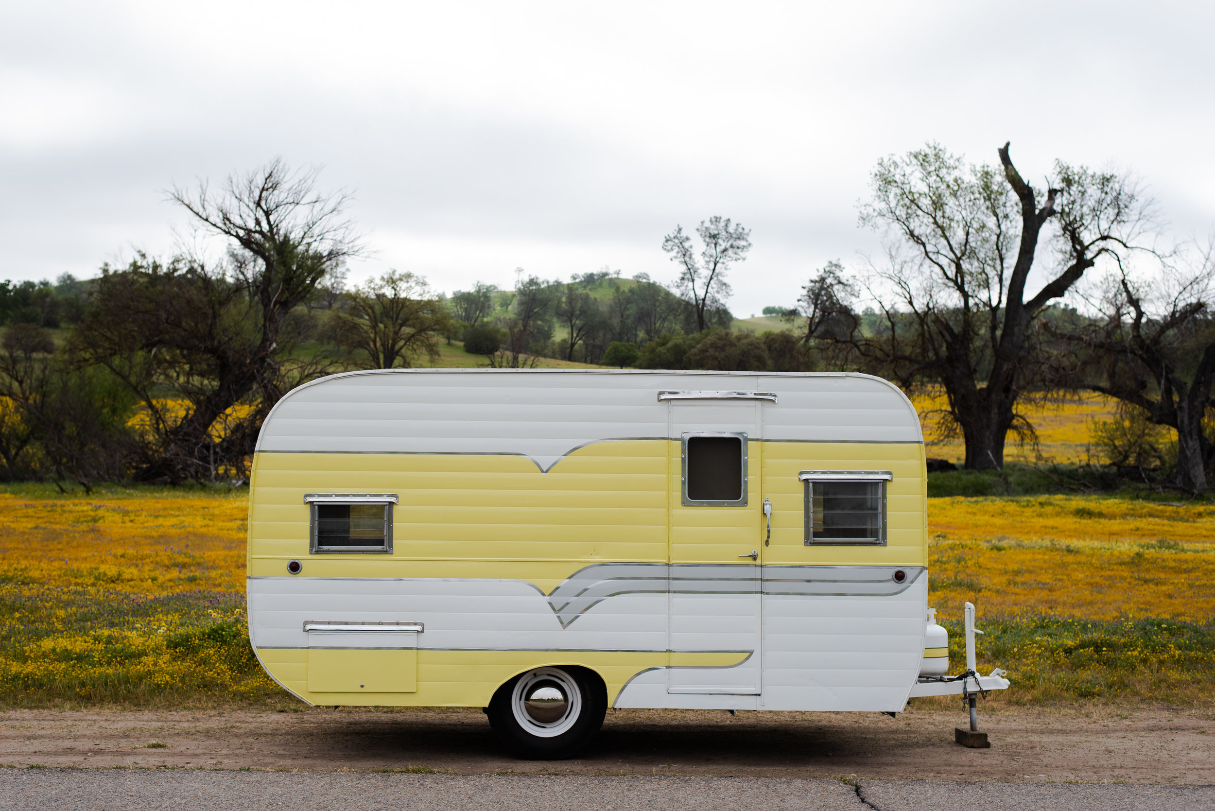 1956 Deville Yellow and White Camper Trailer