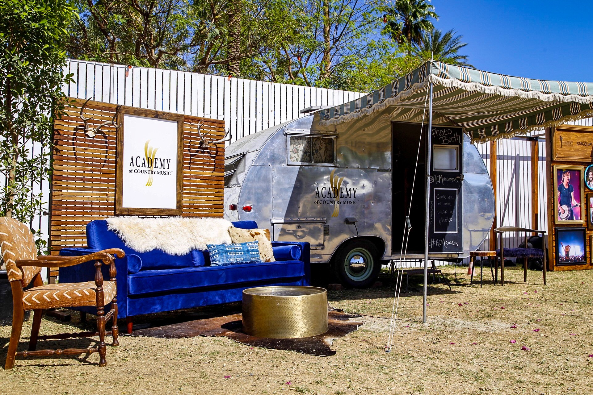 Custom branded vintage photo booth trailer trailer with styled lounge + step & repeat wall