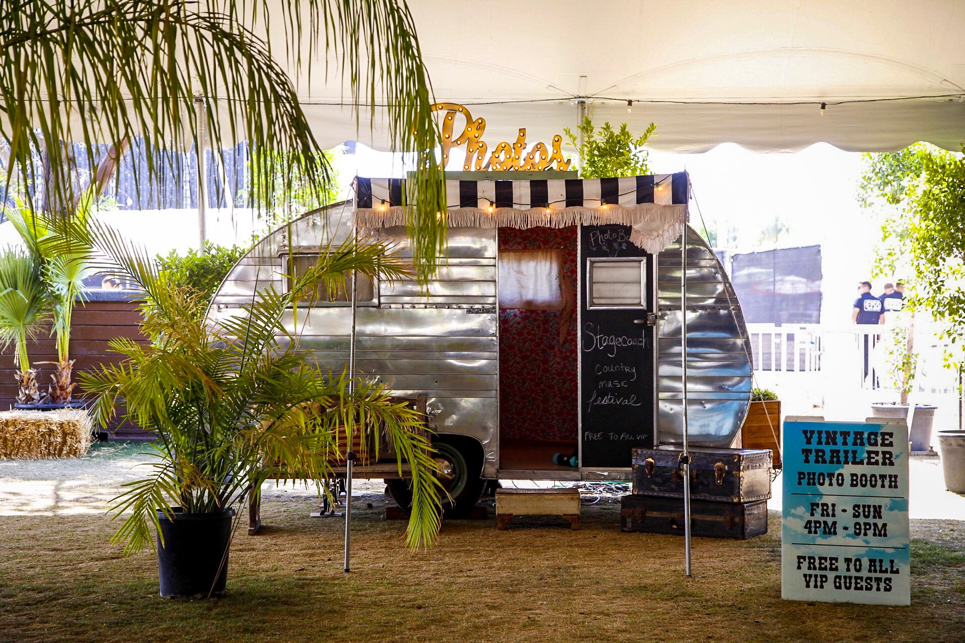 Silver vintage photo booth trailer that can be custom branded for your wedding, corporate event or experiential marketing campaign. Perfect for festivals, celebrations and large or intimate events.