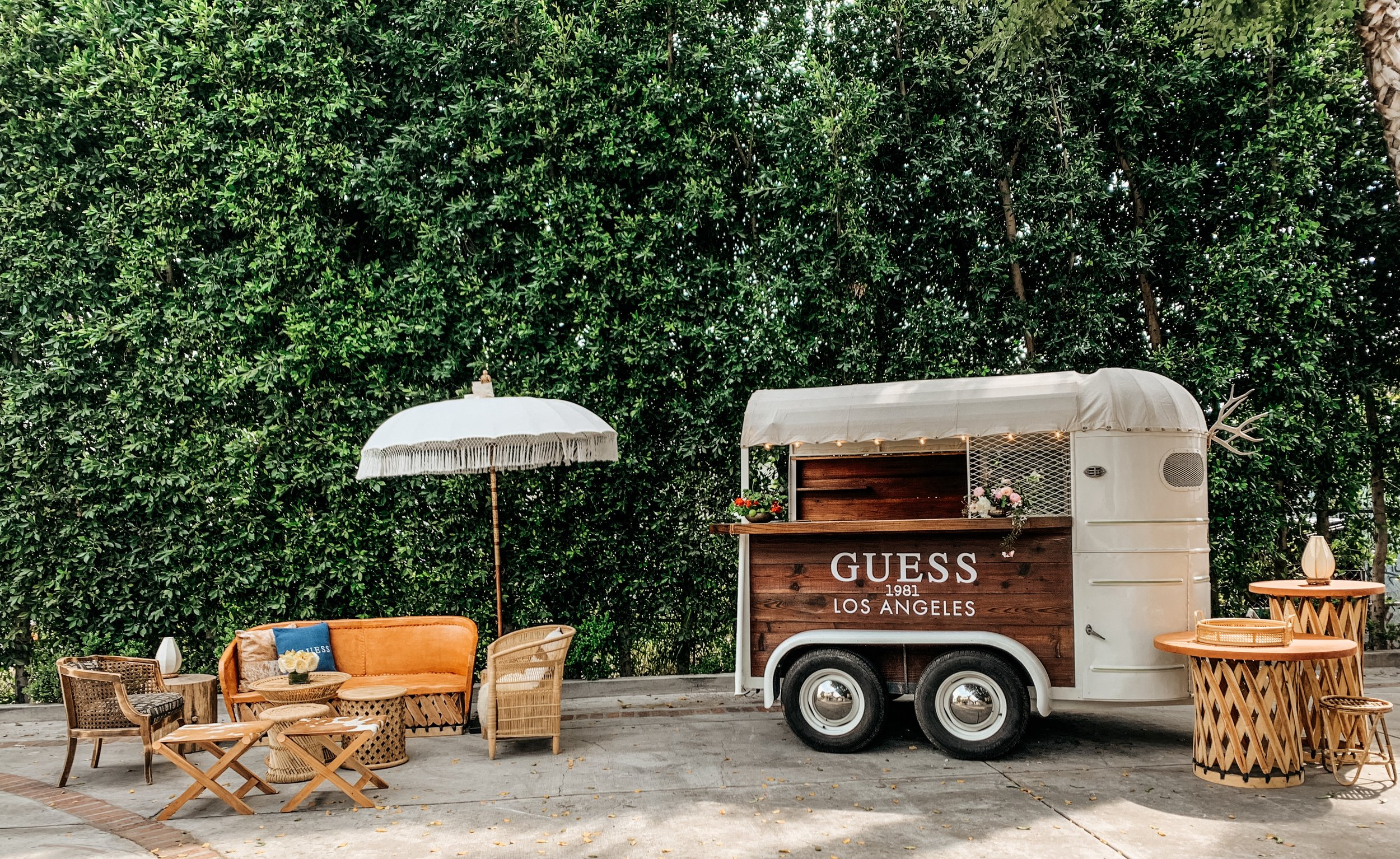 Custom branded vintage trailer trailer with styled lounge + step & repeat wall for rent