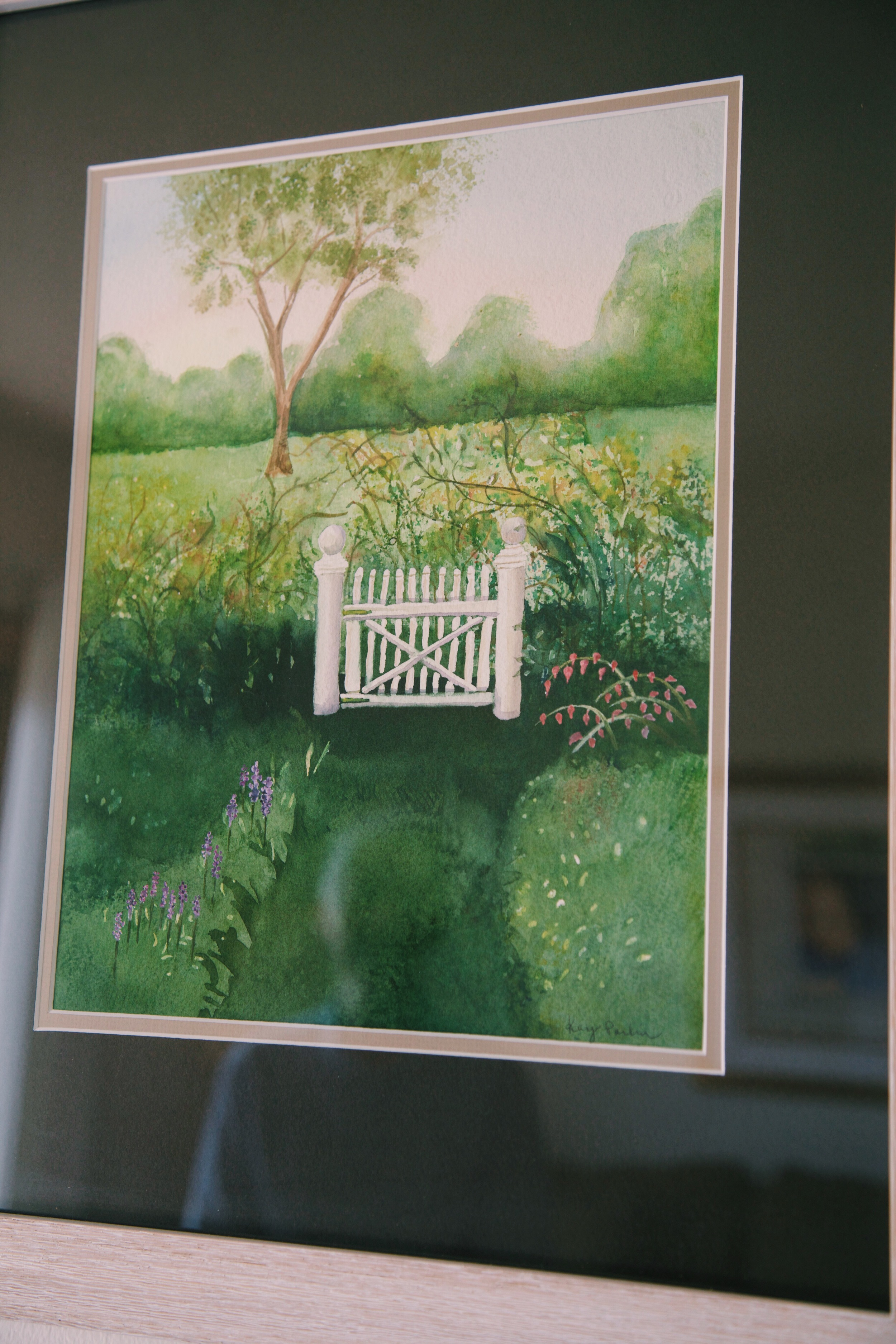 """This is a watercolor I did. I think this is what I will see when I die. I'll walk right through that little garden gate and meet God."""