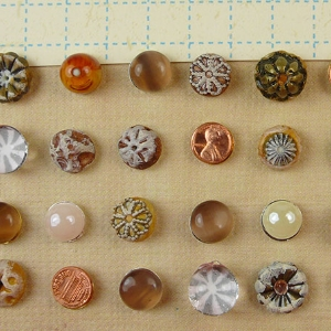 Doll scale buttons