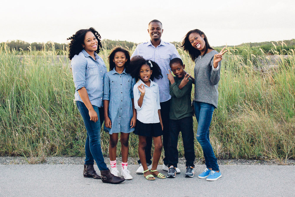 Tiana and her family. See more of her photography and writing at  Kai Noelle .