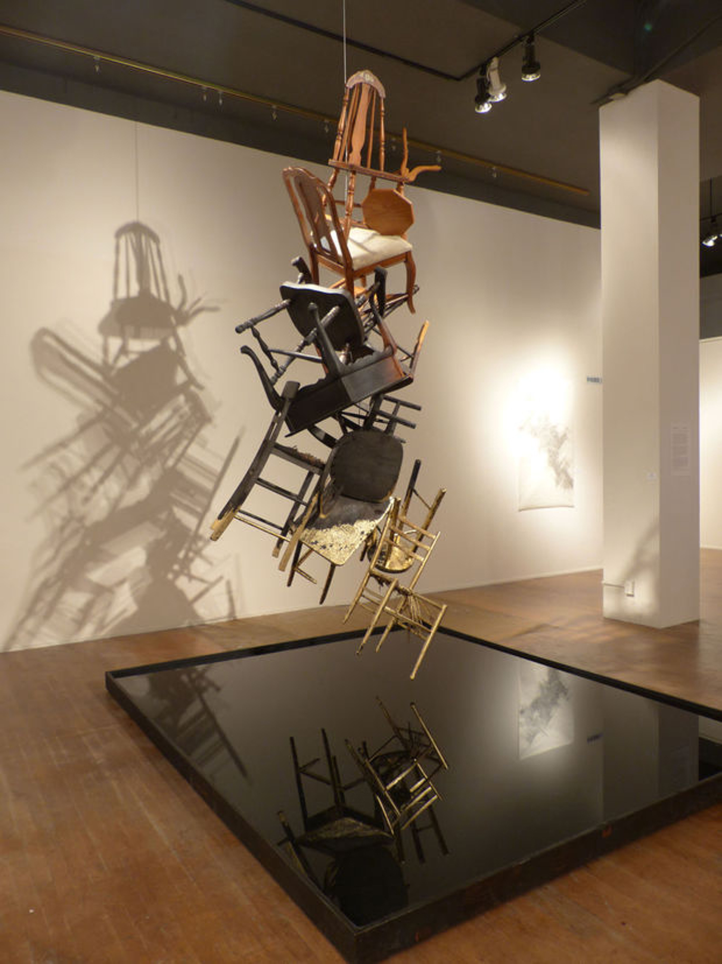 Phoenix   Furniture, fire, gold leaf,wood, and water  Installation at the Coos Art Museum  2015