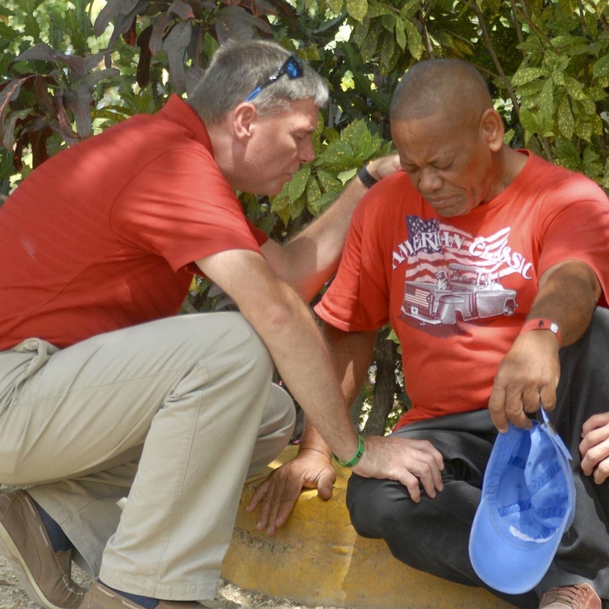 Mark praying with Jose Miguel.jpg